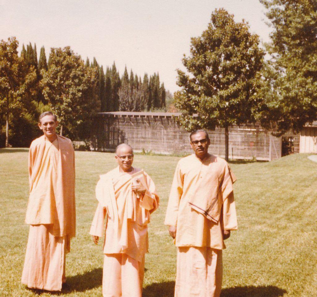 Swami Shraddhananda with Swami Tathagatananda and Swami Bhaktimayananda in the lawn