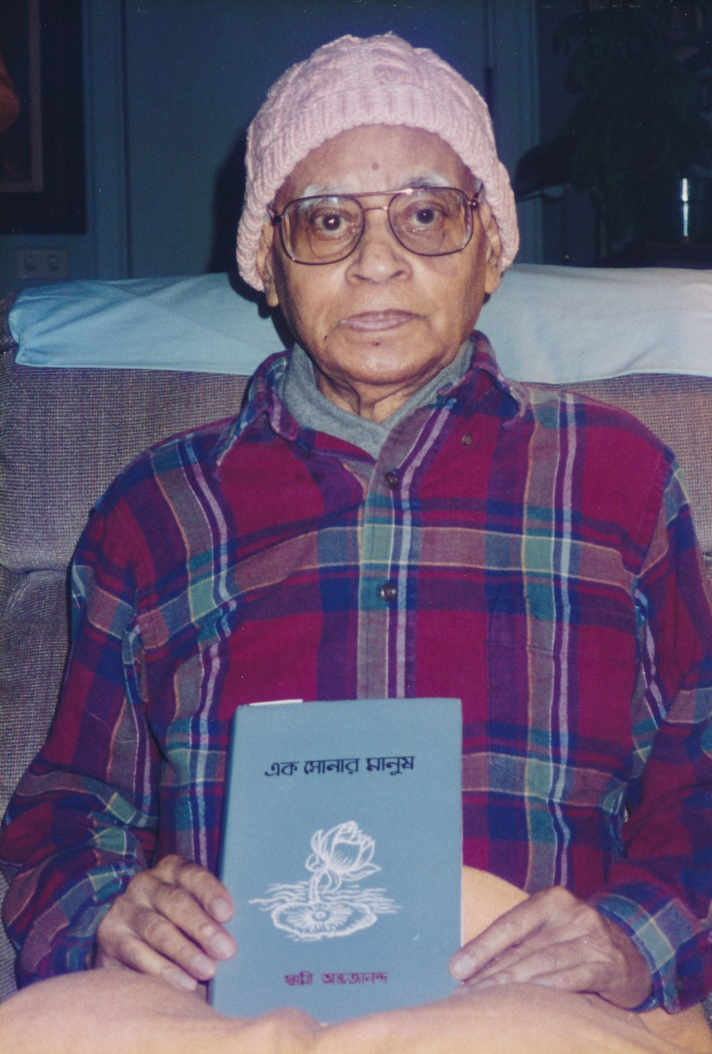 Swami Shraddhananda with a book in hand
